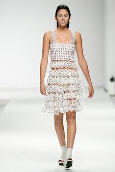 """Fashion Show  """"The collection is designed by Fraga and handmade by the cooperatives using recycled aluminum pull-tabs and crochet. Each dress is a work that requires hundreds of hours to complete."""""""