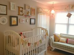 Bunting flags on the crib...but wouldn't the baby grab these? Cute idea though