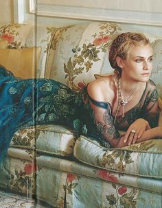 Diane Kruger reclining a sofa upholstered in Colony Villa Lante Stripe