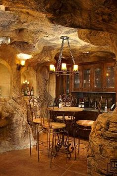 Rustic Wine Cellar with Built-in bookshelf, Chandelier, Concrete tile, Wall sconce