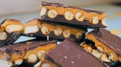 Chocolate Peanut Butter Pretzel Bars!    Ingredients  1 (12 oz.) bag semi-sweet chocolate chips  1 cup creamy peanut butter  1 cup powdered sugar  1/2 cup (1 stick) unsalted butter, melted  pretzel sticks or rods, as needed
