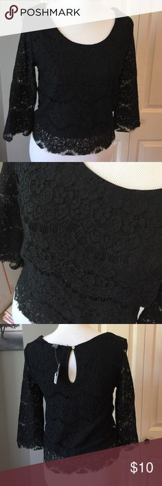 Black Lace Top. Nwt Button at the back of the neck. Lined bodice. 75% cotton 25% nylon Rue 21 Tops Blouses