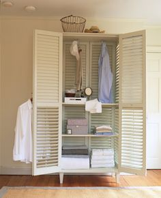 Four large shutters make a breezy and beautiful armoire. (Martha Stewart Living)