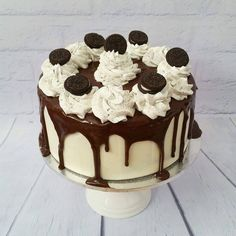 Oreo Madness Cake  Chocolate mud cake with Oreo chunks covered in white ganache with drizzled chocolate ganache and oreo flavoured buttercream.