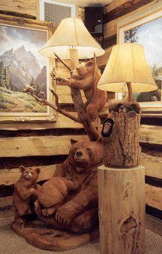 Family of bears enjoying a tree lamp.