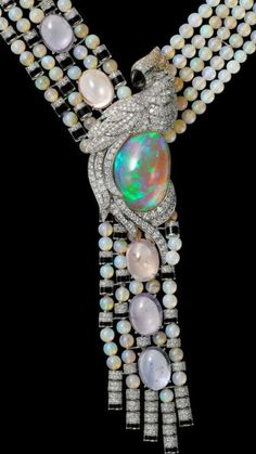 CARTIER Magicien collection- High Jewellery Necklace- Platinum, Opals, purple Sapphires, Onyx, gray Mother- of-Pearl, Emeralds, brown, orange and yellow Diamonds, white Diamonds.