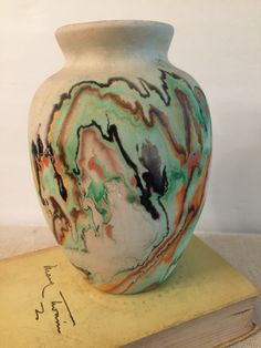 A personal favorite from my Etsy shop https://www.etsy.com/listing/253007453/nemadji-vase-native-clay-mid-century