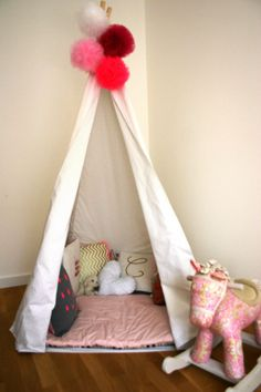 Play tipi tent with giant pom poms