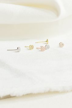 Mixing metals with these delicate and dainty paveé mini stud earrings in 14K gold, rose gold and sterling silver.