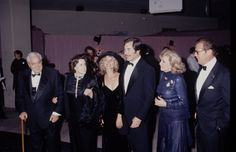 Cubby Broccoli his wife Maryam d'Abo Timothy Dalton Roger Moore and wife attending 70th Birthday Party for Henry Mancini on April 19 1994 at Pauley...