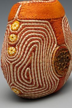 "Jan Hopkins, ""Vibrant""  6""x6.6""x3.5"", 2006, orange peels, waxed linen, yellow cedar bark, ostrich shell beads and lotus pod tops, photo credit: Ken Rowe, Private Collection"