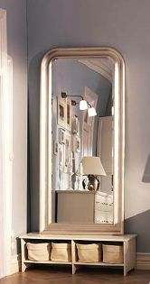 Hallway mirror idea, propped on a small table. Picture of Ikea Songe mirror and Smadal tv stand.