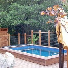 Original Endless Pools® - Partially inground, this Endless Pool was custom built into a spacious backyard deck.