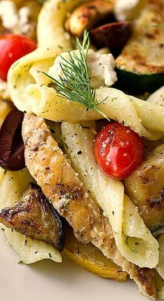 Warm Mediterranean Pasta Salad with Grilled Vegetables, Crumbled Feta Cheese, Kalamata Olives and Grilled Chicken, Tossed in a Creamy, Lemon-Dill Vinaigrette