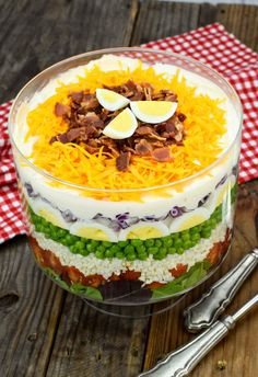 7 Layer Salad Recipe (With Video!) - - This 7 Layer Salad combines fresh veggies, hand mixed dressing, and delectable toppings for a fulfilling meal! Good luck keeping eyes and forks at bay! Egg Salad Recipe Miracle Whip, Basic Egg Salad Recipe, Seven Layer Salad, Salad Ingredients, Healthy Salad Recipes, Delicious Recipes, Cheddar, Soup And Salad, Quinoa
