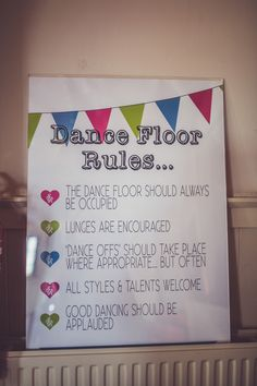 Bunting Dance Floor Rules Graphic Sign - Image by Claire Penn Photography - Suzanne Neville Lace Wedding Dress & Kurt Geiger Shoes for a Rustic Village Hall Venue decorated with gorgeous Bright Flowers, DIY Decor & Light Up Letters.