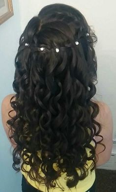 I styled my daughter's hair for her First Holy Communion. Waterfall braid, wand curls and jewels.