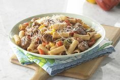 Bring the flavors of a sausage and peppers sandwich from an Italian street fair to your table with this weeknight pasta dish. Our easy video shows you how.