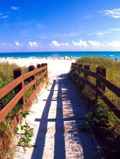 love the feeling of walking down a boardwalk to a warm and sandy beach!