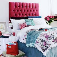 Raspberry velvet headboard and floral fabrics - Carolyn Donnelly designs