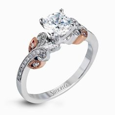 Diamond engagement ring with rose gold accents #simong #wedding