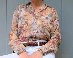 Sheer floral blouse by Outback Red. Buttons up with a lovely floral print in Fall colors. Floral Blouse, Vintage Tops, Flower Prints, Button Up, Shirt Dress, Lady, Long Sleeve, Mens Tops, How To Wear