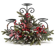 "#burtonandburton Snowy pine candleholder with red berries and pine cones on a metal form that holds 3 candles.Candleholders are 4"" diameter.14""H X 17""W X 7""D.1 set of 2."