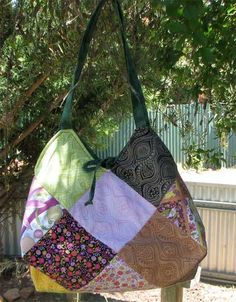 I have a similar pattern to this but it's crocheted (or knitted). Charm Square Jewel Bag - Free Sewing Pattern by The Mad Quilter Bag Pattern Free, Tote Pattern, Bag Patterns To Sew, Sewing Patterns Free, Free Sewing, Quilted Purse Patterns, Patchwork Patterns, Pattern Sewing, Patchwork Bags
