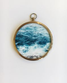 Miniature oil painting on panel Antique brass frame and convex glass. 7.5cm diameter Signed and dated at the back.