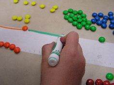 A Meter of Candy - lesson on metric system and fractions/percents.