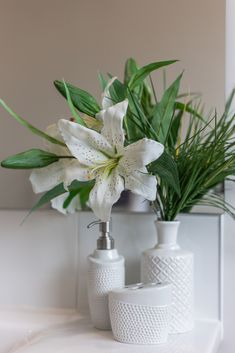 Popping a small vase of flowers onto your vanity is an easy way to add colour and a touch of luxury to your bathroom. Bathroom Flowers, Flower Vases, Bathroom Accessories, Home Interior Design, New Homes, Vanity, Touch, Colour, Trends