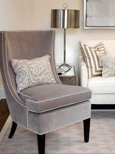 living rooms - Cloverdale Paint - Golden Pastel - gray velvet nailhead trim chair white gray silk pillow white sofa chrome lamp Sarah Richardson