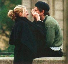 Carolyn Bessette Kennedy-A black cape; how Parisian! In Paris with a beret-clad John!