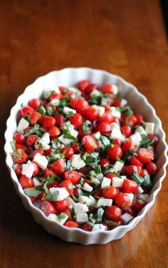 Italian Caprese Chopped Salad :: Ingredients 1/4 cup Balsamic Vinegar, 2 packages of grape tomatoes (sliced each in half), 12 ounces Mozzarella Cheese balls (diced into pieces), Fresh Basil Leaves (shredded), 1/4 cup Olive Oil, Kosher Salt And Freshly Ground Black Pepper - Toss all ingredients together and serve!