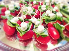 Easy hors d'oeuvres - grape tomato, basil leaf, pearl Mozzarella, toothpick, drizzle with Balsamic vinegar!