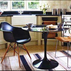 Yeah! Black Saarinen tulip table and Eames Eiffel chair. Want. So. Bad.