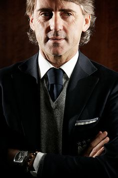 Credit: Christopher Thomond for the Guardian Then Manchester City manager Roberto Mancini pictured at Manchester airport.