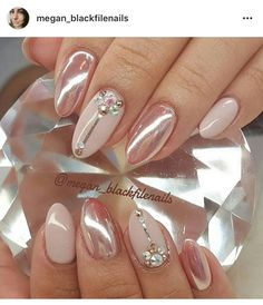 Nude, rose gold chrome, and crystal nails.