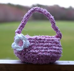 Crocheted fabric basket - can be easter, spring, etc.  Try making with T-shirt yarn??  Add decorations.