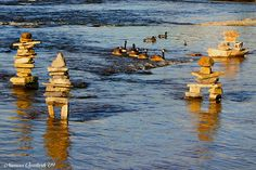 Inukshuks in Ottawa by Numan Q. Fishing Places, Beautiful Places To Live, Canada Eh, Travel Route, Arctic Circle, Ancient Symbols, Cairns, Rock Stars, Birdhouse