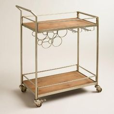 Complete your home bar setup with our sleek and stylish cart, crafted of wood and metal. With a built-in wine rack, this four-wheel cart is simple to assemble and can be stocked with spirits, mixers and other bar essentials. Diy Bar Cart, Gold Bar Cart, Bar Cart Decor, Bar Carts, Golf Carts, Metal Bar Cart, Rolling Bar Cart, Home Bar Setup, Built In Wine Rack