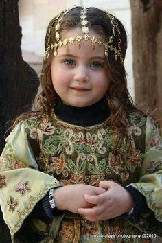 Blue-eyed Palestinian girl.  She looks like a medieval princess.