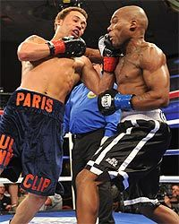 Unbeaten super lightweight Vernon Paris boxes with a bullet an inch from his spine