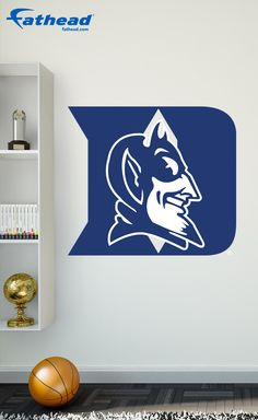 The Duke Blue Devils Logo features images licensed by the school, so you don't have to settle for a cheap knockoff wall decal without the team's official logos. And the logo doesn't require tape, tacks or putty like a poster. SHOP http://www.fathead.com/college/duke-blue-devils/duke-blue-devils-logo-wall-decal/ | College | DIY Bedroom Decor for Boys + Girls | Custom Decals | Peel & Stick | Man Cave