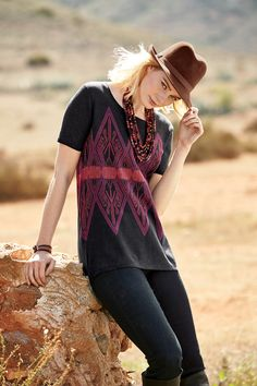 The pattern's colors would look great with the brick red jeans. Love this combo! Bolaven Top, Bree Straight-Cut Jeans, Brandywine Fedora, Cocachimba Necklace, Burgundy Cuzco Bracelet