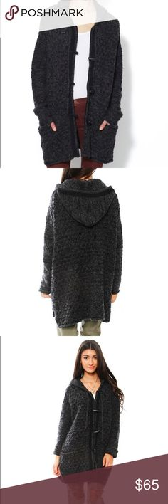 NWOT FP FREE PEOPLE TURN UP THE SUN CARDIGAN XS Style: 29079720/F113X949  Color: Charcoal  THIS IS BRAND NEW. Closet clean out! Another beautiful sweater that ended up neatly folded in a bin inside my closet. I have this in the cream and love it but the acrylic/wool combo kills my very sensitive skin. Therefore, I won't be wearing this color ever! Brand new without tags. Texturized knit cardigan with zipper and toggle button closure in the front. Attached hood.   *60% Cotton *23% Acrylic *9%…
