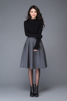 """The gray skirt is made of wool blend, the wool skirt has a polyester lining inner The midi skirt has Two side pockets The grey wool skirt is closed by Side zipper The skater skirt for women has Pleated on the skirt Shop sizing chart FYI ( made according to US sizing. actual body figures, NOT laying flat clothes measurements) SIZE (US 0, UK 4, Italian 34, French 32, German 30, Japan 1) bust: fits bust around 32.5"""" / 82.5cm Waist: fits waist around 25"""" / 64cm Hips: fits hips around..."""