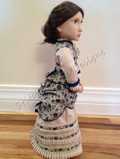 Navy and Tan bustle dress for dolls such as A Girl for All Time Navy Ribbon, Ribbon Bows, Bustle Dress, Navy Flowers, Pleated Fabric, French Seam, Lace Ruffle, Fashion Plates, Buttonholes