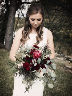 Queen protea bouquet, burgundy and blush, photo by #jennsportraitphotography