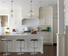 love those bubble pendants. And the white kitchen.